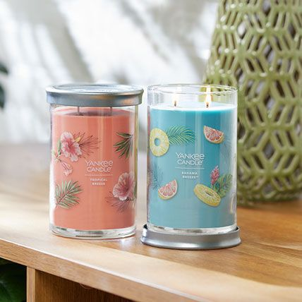 tropical breeze and bahama breeze signature large tumbler candles on table